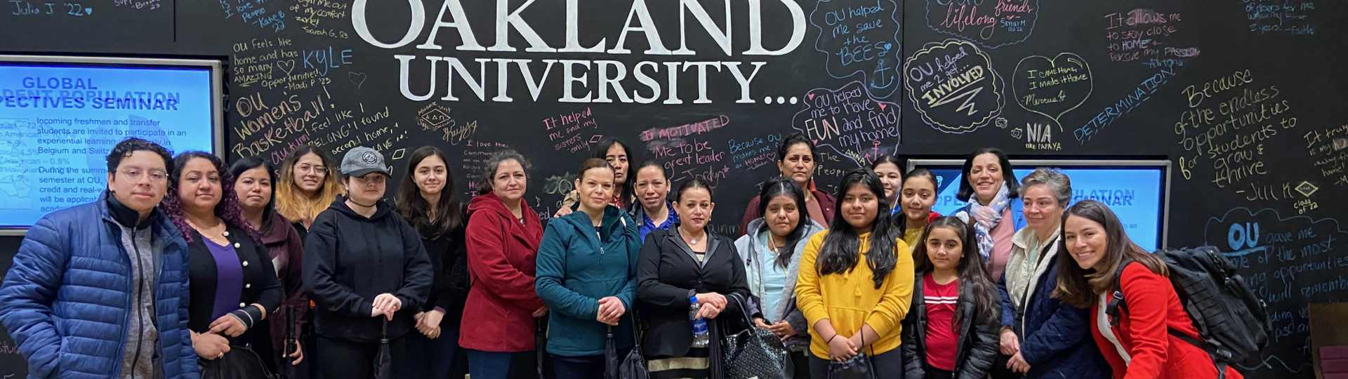 A large group of MIHC parents and students at an event at Oakland University.